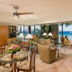 Premium Oceanfront Suite Living Room With Couple