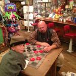 Enjoying a game of checkers in the general store