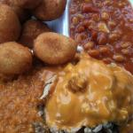 Small carry out plate.  Chopped bbq, hash, hush puppies, and baked beans.