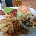 Salmon club sandwich with fries, dill dip and Ceasar salad.