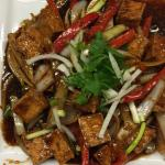 Stir fry tofu with lemon grass, chili, bell pepper and onion sauce