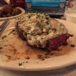 9oz filet cooked perfectly to medium rare. Topped with blue cheese. It was delicious!!!