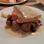 Pan fried cod with roast potatoes, carrots and braised red cabbage