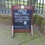 The billboard advertising Café West at the entrance to Keswick's Fitz Park