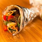 Check out Pimento's jerk pork wrap. Great for catering!