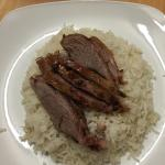 Slices of roast lamb drizzled in hoi sin sauce with streamed rice mmm lovely !