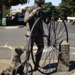 Evandale statue of man, dog and penny farthing bike
