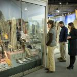 Visitors taking a closer look at the artifacts on display in the Oyate Tawicoh'an Gallery.