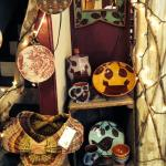 Examples of regional craft -- basketry, earthenware & mirrors, vintage & recycled fabric pothold