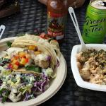 Fish tacos, Poké with rice, local Raging Volcano hot sauce, local Ito En green tea
