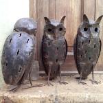 Metal owl statues.