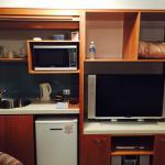 Studio kitchenette and large tv
