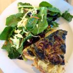 Spinach and onion quiche with salad