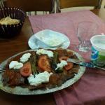 Beef kebab with tomato sauce and yoghurt, pita bread, ayran