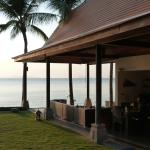 Once you are done by the pool, watch sunset from this covered lounge area.