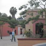 The pedestrian street beside it leads to the Cruz de Piedra