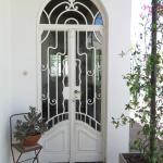 Fleur-de- lis/ Entrance door