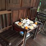 Breakfast at entrance balcony of Economy Chalet room (#5)