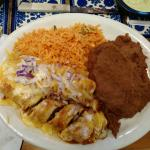 Two beef enchiladas with rice and refried beans