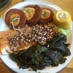 Delicious! Trout, green fried tomatoes and greens.