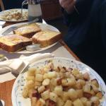 French toast and a plate of hash browns