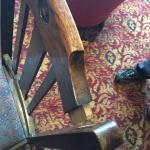 One of the two broken chairs in the bar area.