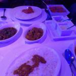 Chicken tikka masala and chicken madras with mushroom bhaji and Bombay potatoes