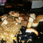Fried rice with veggies, along side filet migeon scallops and shrimp. Meats were tender and grea