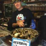 Captain shucks oysters