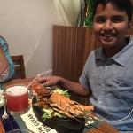 My son enjoying lobster during the sea food festival...