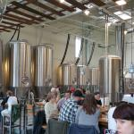 Shot of the Pfriem Brewing tanks from in front of the bar
