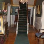 Entry way with the main staircase.