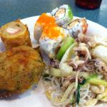 Stuffed crab, spicy squid on rice noodles, sushi and dragon roll.