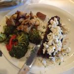 New York strip steak topped with lump crabmeat with roasted red potatoes, broccoli and red peppe