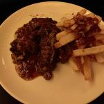 Tail of bull cooked to perfection and served with deliciously prepared fries