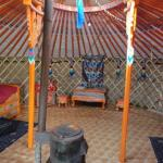 Inside the ger, wood-burning stove in the middle. The beds are to either side. There was also a