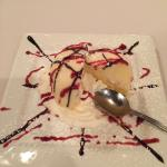Passion fruit sorbet in a white Chocolate with a rasberryand chocolate drizzle