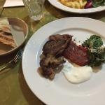 $30 main meal - lamb with tomato, mint and feta salad and pita bread.  Pita was burned on back,