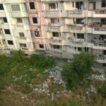 People living here are throwing garbage out of window
