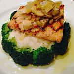 Salmon over a bed of mashed potatoes and broccoli...