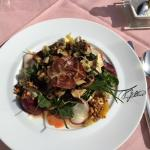 spring salad topped with field and forrest mushrooms , beets and roasted waluts