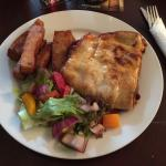 Lasagne served with chips and salad