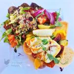 Mediterranean vegetables and halloumi on ciabatta with a toasted seed salad.
