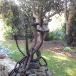 some if the rustic old farm equipment now a sculture in the lovely gardens