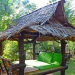 Little shady huts in the hotel garden near pool