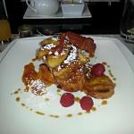 Brioche Raisin French Toast with Caramelized Bananas, Raspberries & Maple Syrup !
