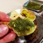 The pakora with the green herb sauce. In the background is the rest of the 5-appetizer combo.