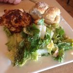 Crab cake with Caesar salad and garlic rolls. Amazing food. Best crab cake I have had in years!