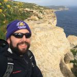 Sitting atop of San Lawrenz cliffs [view towards Kercem/Xlendi]