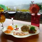 A plate of Sashimi and drinks at nearby Volcano House restaurant overlooking Kilauea crater.